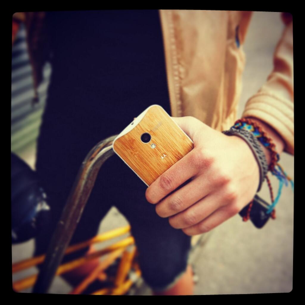 Moto X, featuring a wooden cover
